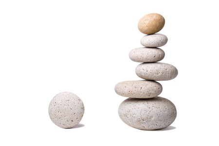 A stack of slightly off-balanced zen stones isolated on white background  photo