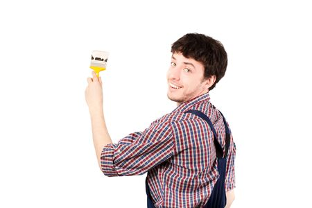 housepainter: Happy housepainter painting, looking at camera & giving a beautiful smile Stock Photo