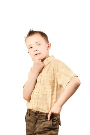 niños pensando: Retrato de un adorable niño aislado en blanco Foto de archivo