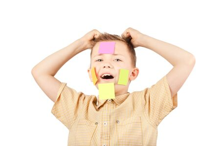 Portrait of a boy with colorful funny stickers on his face.
