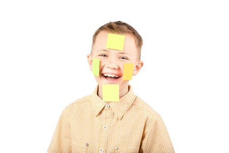 Portrait of a boy with colorful funny stickers on his face. photo