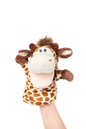 Hand puppet of giraffe isolated on white, happy confused.  Standard-Bild