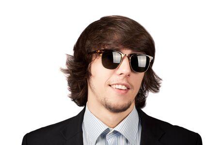 stilish: Young stilish man in sunglasses smiling. Isolated on a white Stock Photo