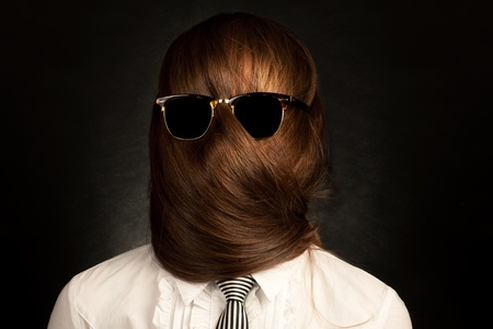 Ð¡onceptual photo of young woman with very long hair which covers her face. Stock Photo - 12904279