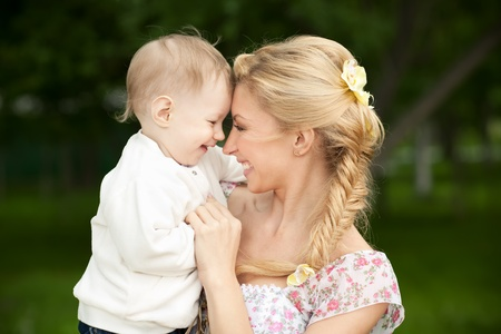 blonde mom: Happy blonde mom and son outdoors