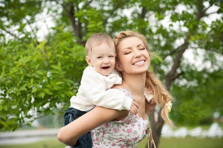 picture of happy baby with mother enjoying nature photo
