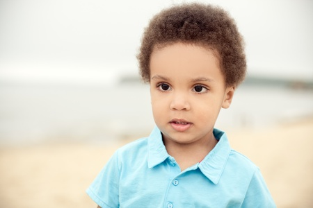 cute african american boy on a background of sand & sea Stock Photo - 12905784