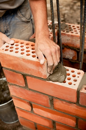 Construction. Bricks laying.  photo