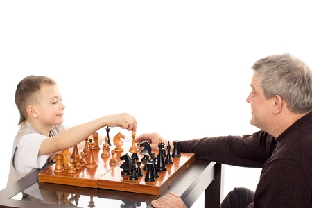 Grandfather and Grandson having a game of chess on a white background