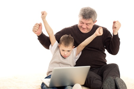 Grandfather and Grandson playing on a white background Stock Photo