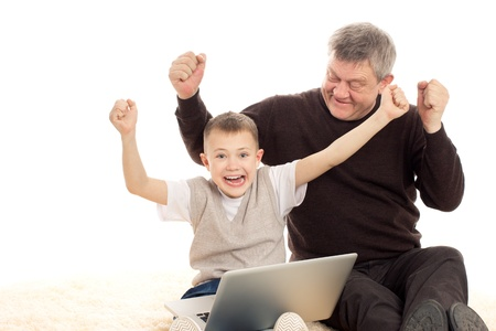 Grandfather and Grandson playing on a white background Standard-Bild