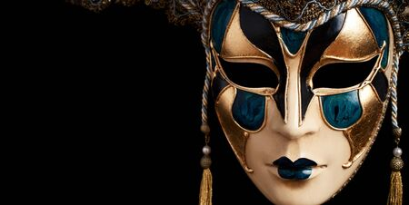 carnival mask: Carnival in Venice image with ample copyspace. Isolated On black Stock Photo