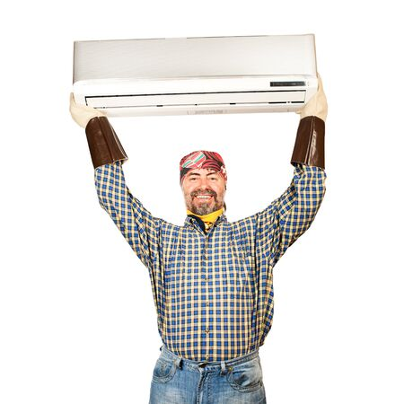 mounter: Air conditioning master holding in his arms new air conditioner and smiling  Isolated on a white  Stock Photo