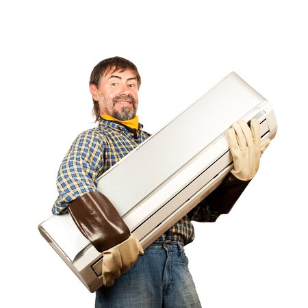 Air conditioning master holding in his arms new air conditioner and smiling  Isolated on a white  Stock Photo