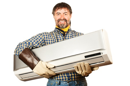 millwright: Air conditioning master holding in his arms new air conditioner and smiling  Isolated on a white  Stock Photo
