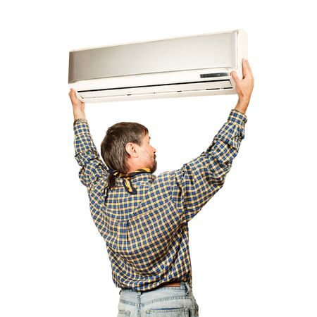 mounter: Air conditioning master installing a new air conditioner  Isolated on a white