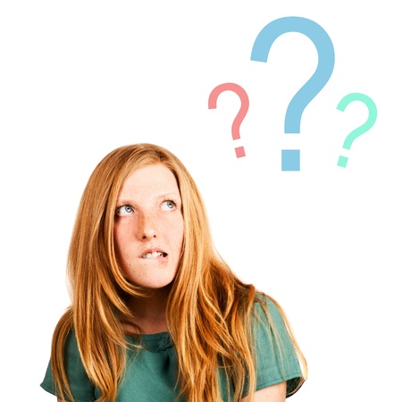 thinking red-haired girl isolated on a white, looking at questions marks. rich face expression