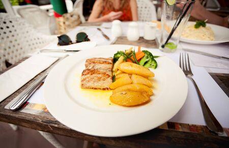 potato tuna: grilled tuna with potatoes and greens Stock Photo