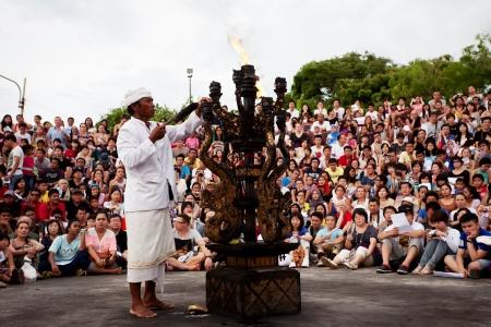 kecak: BALI - DECEMBER 30: man lights a fire before traditional Balinese Kecak dance at Uluwatu Temple  on DECEMBER 30, 2012, Bali, Indonesia Editorial