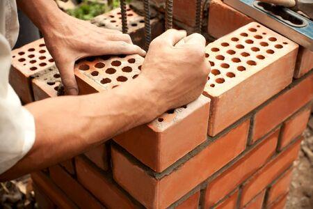 Construction. Bricks laying. photo