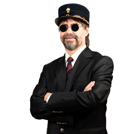 stilish: Stilish man in  gendarme stile  hat and in sunglasses smiling Stock Photo