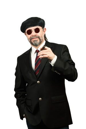 Closeup portrait of stilish man in beret and in sunglasses smoking cigar Stock Photo - 19821946