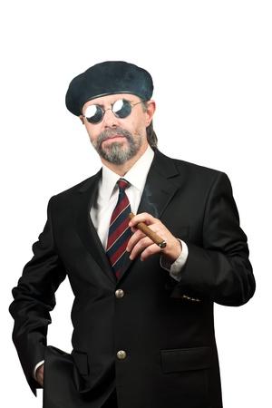 stilish: Closeup portrait of stilish man in beret and in sunglasses smoking cigar