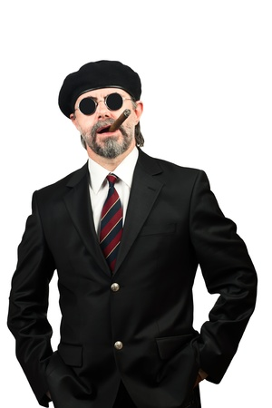 Closeup portrait of stilish man in beret and in sunglasses smoking cigar Stock Photo - 19821948
