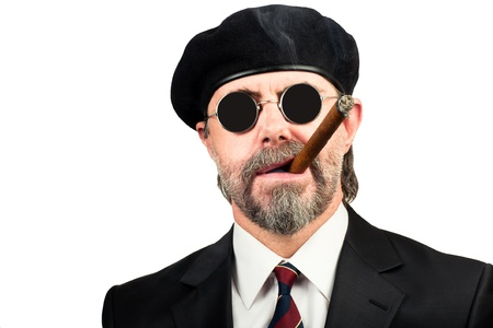 Closeup portrait of stilish man in beret and in sunglasses smoking cigar Stock Photo - 19822068