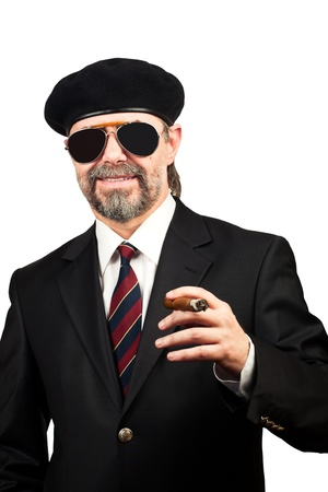 Stilish man in beret and in sunglasses holding cigar