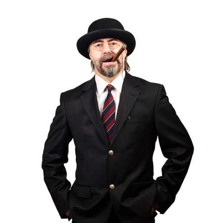stilish: portrait of stilish man in black hat and in glasses smoking cigar Stock Photo