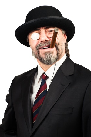 closeup portrait of a senior businessman in hat and glasses smoking cigar and smiling