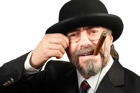 Closeup portrait of stilish man in beret and in glasses smoking cigar and looking at you