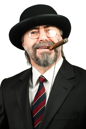 Closeup portrait of stilish man in a hat and in glasses smoking cigar and looking at you Standard-Bild
