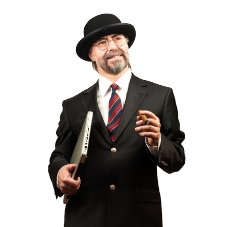 Portrait of a senior businessman holding notebook and cigar, looking at sopy space