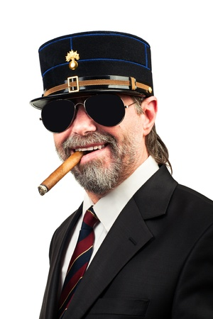 Closeup portrait of stilish man in   gendarme stile  hat and in sunglasses smoking cigar, smiling photo