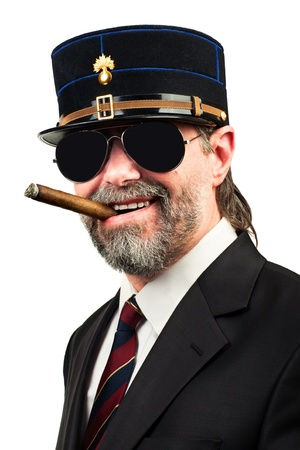 stilish: Closeup portrait of stilish man in   gendarme style  hat and in sunglasses smoking cigar, smiling
