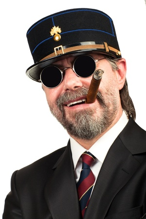 stilish: Closeup portrait of stilish man in   gendarme stile  hat and in sunglasses smoking cigar, smiling