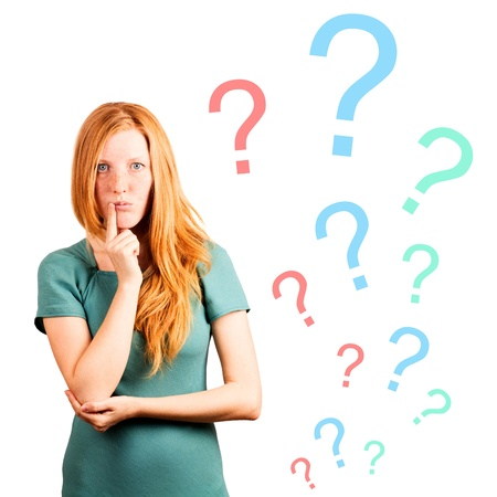 i t: thinking red-haired girl isolated on a white, questions marks at background  Stock Photo