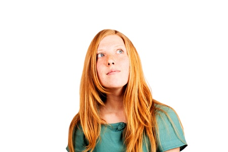 Happy red-haired woman looking up