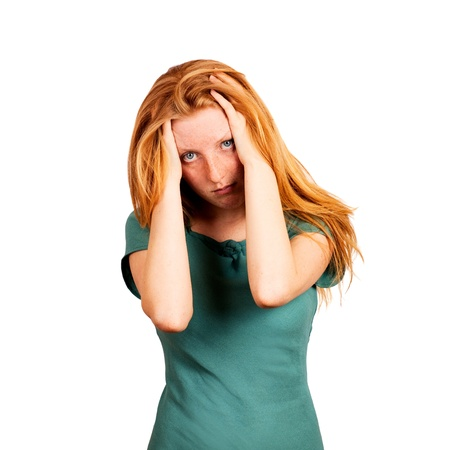 Red-haired woman expressing fatigue and headache Standard-Bild