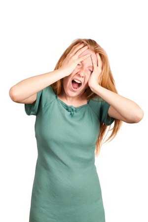Red-haired woman screaming and expressing pain Standard-Bild