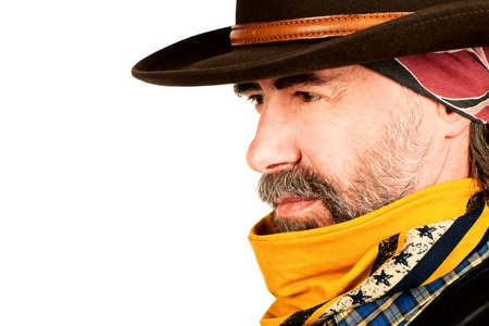 Closeup portrait of american cowboy looking at copyspace. on white background Standard-Bild