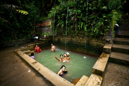 BALI - JANUARY 3 :  People take a bath in termal Banjar Tega hot springs on JANUARY 3, 2013, Bali, Indonesia