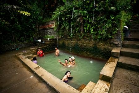 BALI - JANUARY 3 :  People take a bath in termal Banjar Tega hot springs on JANUARY 3, 2013, Bali, Indonesia
