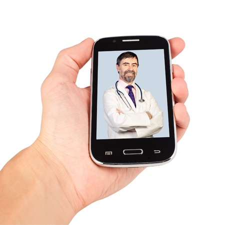 using smartphone: Hand holding smart phone, doctor calling. isolated on white background. All photos on a display are available in high resolution in my portfolio. Stock Photo