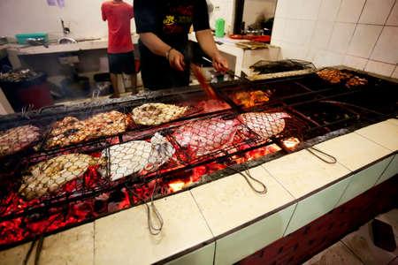 BALI - DECEMBER 30  preparing seafood at restaurant  on DECEMBER 30, 2012, Bali, Indonesia