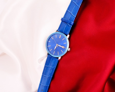 Men s mechanical watch on a background of red and white fabric  photo