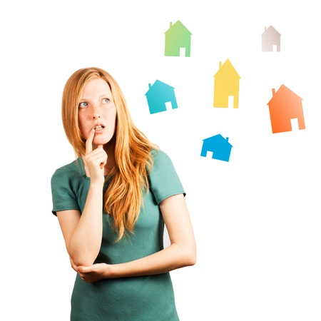 hesitations: red-haired girl thinking  isolated on a white, looking at coloured houses