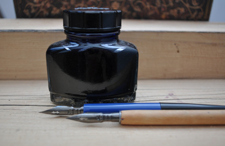 inkwell: inkwell and old pens Stock Photo